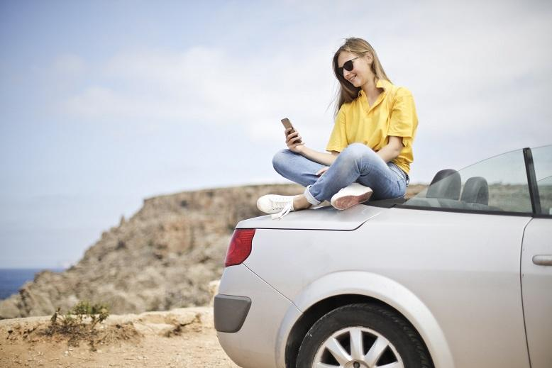 image of woman on car
